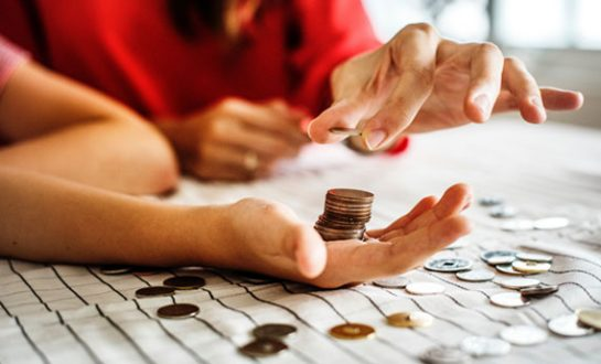 Tenant with coins in hand and on table top