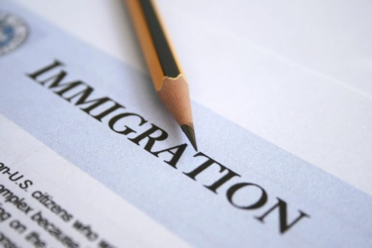 Document with the title immigration with a pencil over it.