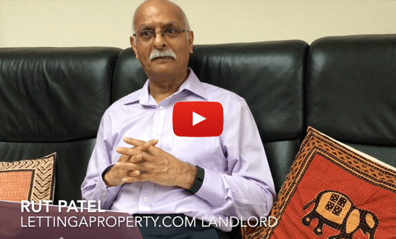 Landlord sat on sofa satisfied with rent guarantee insurance package.