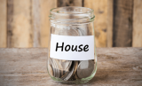 Rent collection service collecting coins in a jar with house label