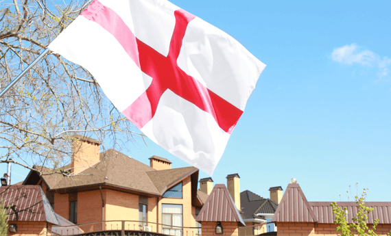 Landlord registration in England is mandatory. House in England with flag let under selective licensing scheme