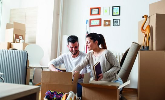 Two tenants unpacking boxes and reading how to let guide