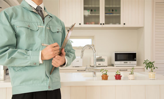 landlord standing in kitchen of property carrying out a property inspection