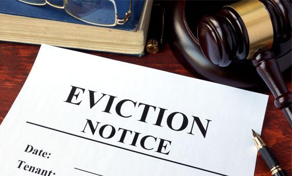 Eviction notice on a desk.