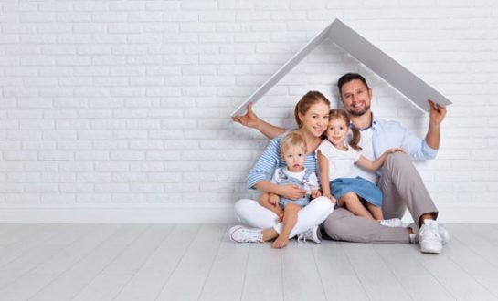 Family holding a roof over their heads
