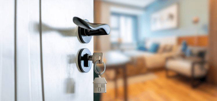 landlord's right to access: a door ajar with a key in the lock