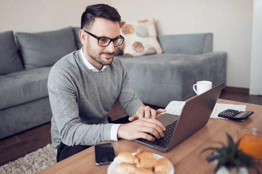 Man sat at his desk completing his tenant reference checks